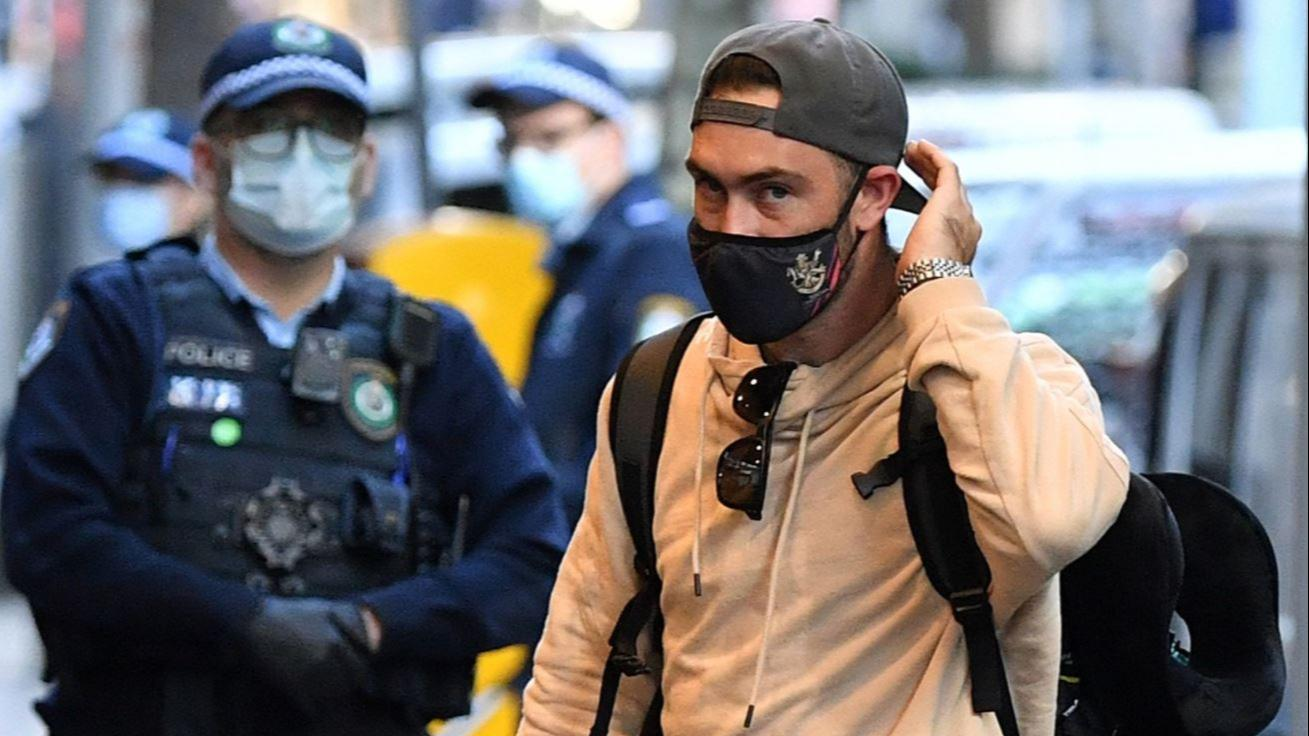 IPLs Aussie cricketers get home but will have to wait to meet their families