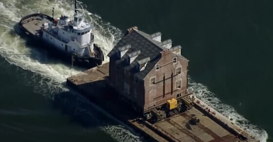 Family moves historic mansion by boat!