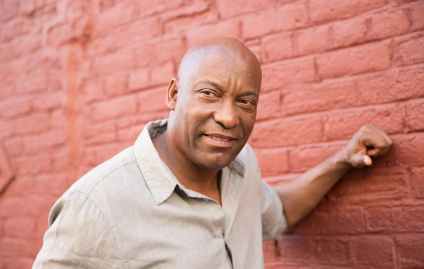 John Singleton's daughter disputes report that he's in a coma