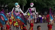 Towering skeletons join dancers at Mexico City's Day of the Dead parade
