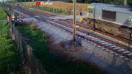 Watch: cyclist narrowly avoids speeding train