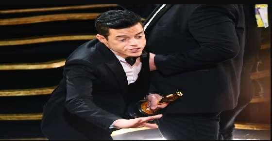 Rami malek falls off the stage with his Best Actors trophy at the Oscars