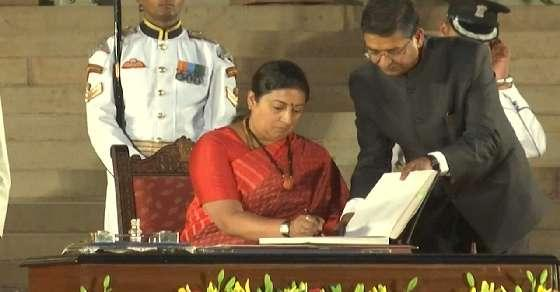 Giant-killer Irani takes oath as Cabinet minister